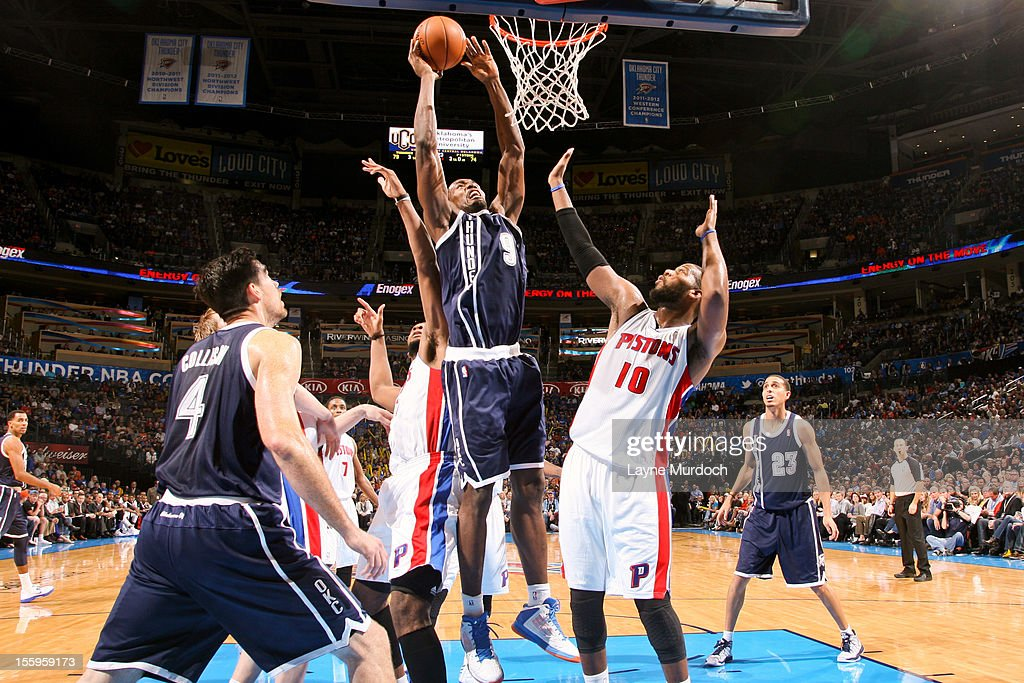 Serge Ibaka #9 of the Oklahoma City Thunder goes to the basket against Greg Monroe #10 of the Detroit Pistons on November 9, 2012 at the Chesapeake Energy Arena in Oklahoma City, Oklahoma.