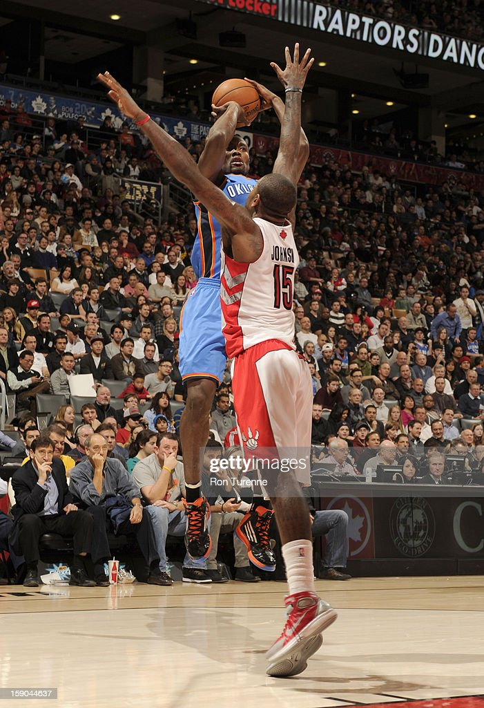 <a gi-track='captionPersonalityLinkClicked' href=/galleries/search?phrase=Serge+Ibaka&family=editorial&specificpeople=5133378 ng-click='$event.stopPropagation()'>Serge Ibaka</a> #9 of the Oklahoma City Thunder goes to the basket against <a gi-track='captionPersonalityLinkClicked' href=/galleries/search?phrase=Amir+Johnson&family=editorial&specificpeople=556786 ng-click='$event.stopPropagation()'>Amir Johnson</a> #15 of the Toronto Raptors during the game between the Toronto Raptors and the Oklahoma City Thunder on January 6, 2013 at the Air Canada Centre in Toronto, Ontario, Canada.