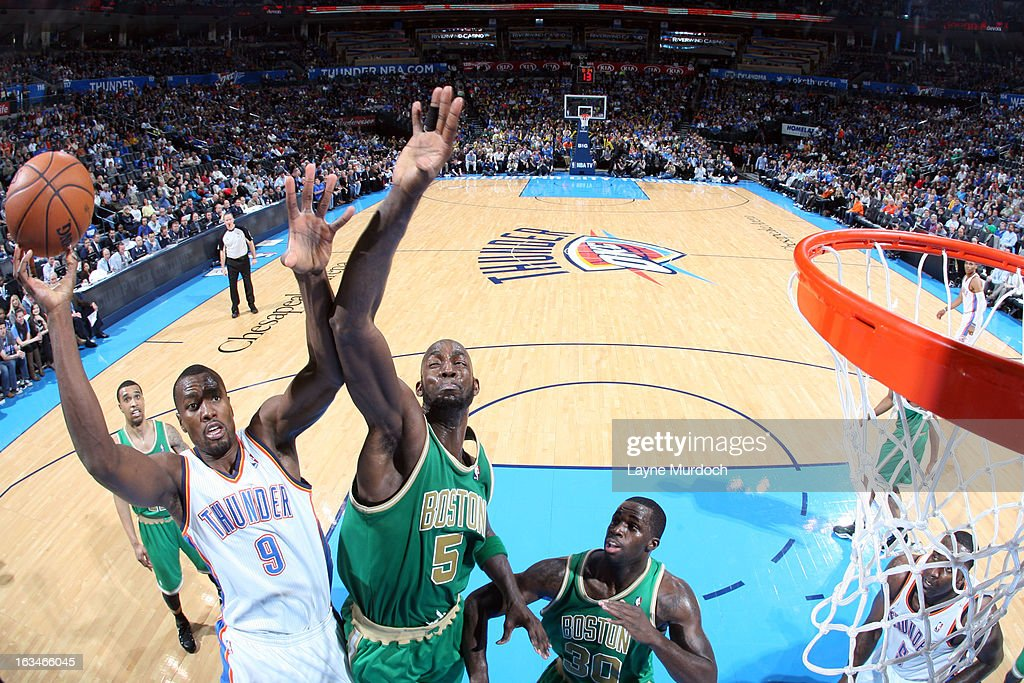 Serge Ibaka #9 of the Oklahoma City Thunder goes to the basket against Kevin Garnett #5 of the Boston Celtics during the game between the Oklahoma City Thunder and the Boston Celtics on March 10, 2013 at the Chesapeake Energy Arena in Oklahoma City, Oklahoma.