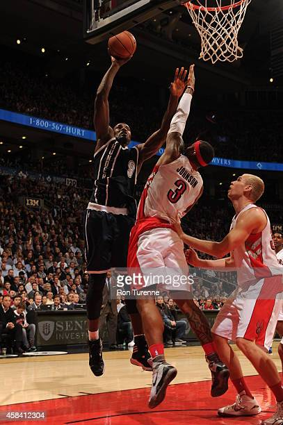 Serge Ibaka of the Oklahoma City Thunder goes to the basket against James Johnson of the Toronto Raptors on November 4 2014 at the Air Canada Centre...