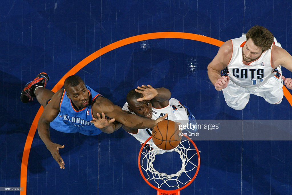 Serge Ibaka #9 of the Oklahoma City Thunder goes up for a rebound against the Charlotte Bobcats at the Time Warner Cable Arena on March 8, 2013 in Charlotte, North Carolina.