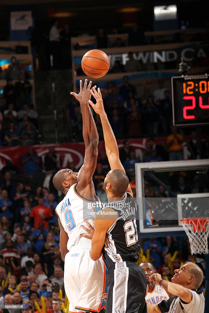<a gi-track='captionPersonalityLinkClicked' href=/galleries/search?phrase=Serge+Ibaka&family=editorial&specificpeople=5133378 ng-click='$event.stopPropagation()'>Serge Ibaka</a> #9 of the Oklahoma City Thunder goes up for the opening tip against <a gi-track='captionPersonalityLinkClicked' href=/galleries/search?phrase=Tim+Duncan&family=editorial&specificpeople=201467 ng-click='$event.stopPropagation()'>Tim Duncan</a> #21 of the San Antonio Spurs during an NBA game on December 17, 2012 at the Chesapeake Energy Arena in Oklahoma City, Oklahoma.