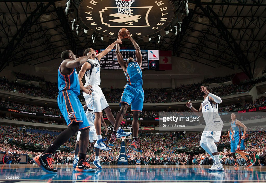 Serge Ibaka #9 of the Oklahoma City Thunder grabs a rebound against the Dallas Mavericks on March 17, 2013 at the American Airlines Center in Dallas, Texas.