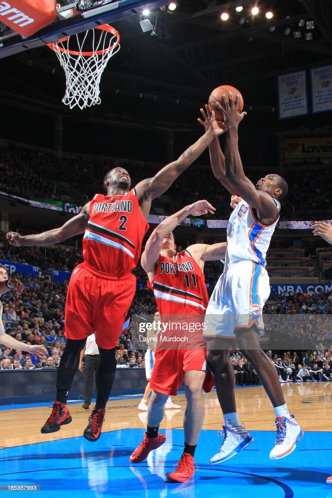 Serge Ibaka #9 of the Oklahoma City Thunder grabs a rebound against the Portland Trail Blazers on March 24, 2013 at the Chesapeake Energy Arena in Oklahoma City, Oklahoma.