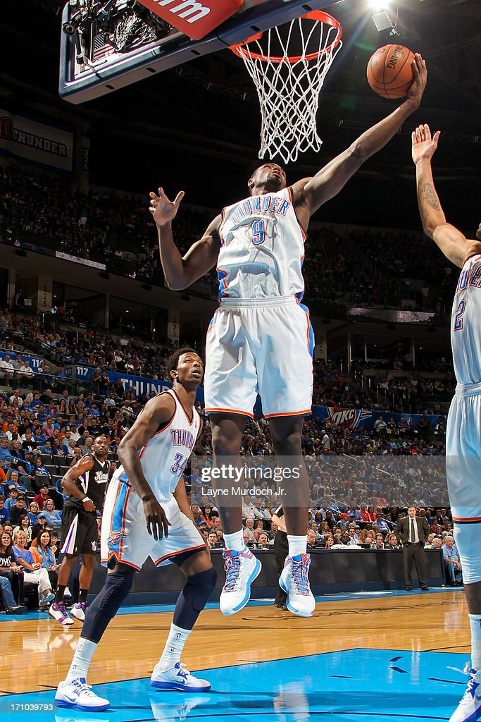 <a gi-track='captionPersonalityLinkClicked' href=/galleries/search?phrase=Serge+Ibaka&family=editorial&specificpeople=5133378 ng-click='$event.stopPropagation()'>Serge Ibaka</a> #9 of the Oklahoma City Thunder grabs a rebound against the Sacramento Kings on April 15, 2013 at the Chesapeake Energy Arena in Oklahoma City, Oklahoma.