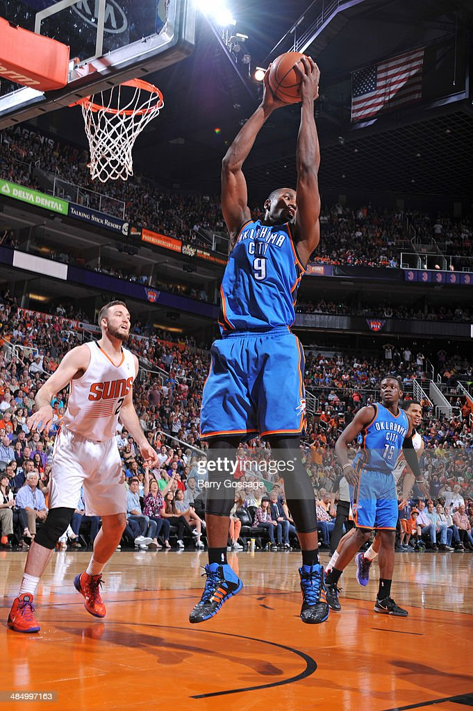<a gi-track='captionPersonalityLinkClicked' href=/galleries/search?phrase=Serge+Ibaka&family=editorial&specificpeople=5133378 ng-click='$event.stopPropagation()'>Serge Ibaka</a> #9 of the Oklahoma City Thunder grabs a rebound against the Phoenix Suns on April 6, 2014 at U.S. Airways Center in Phoenix, Arizona.