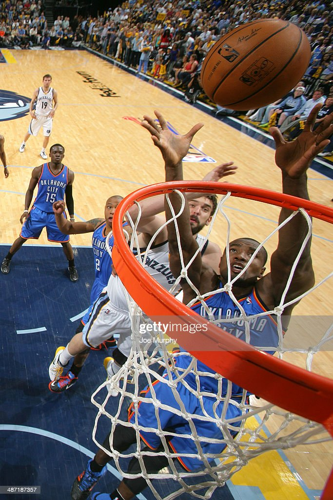 Serge Ibaka #9 of the Oklahoma City Thunder grabs the rebound against the Memphis Grizzlies in Game Four of the Western Conference Quarterfinals during the 2014 NBA Playoffs on April 26, 2014 at FedExForum in Memphis, Tennessee.