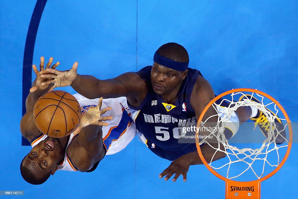 Serge Ibaka #9 of the Oklahoma City Thunder jumps for a rebound against Zach Randolph #50 of the Memphis Grizzlies during Game One of the Western Conference Semifinals of the 2013 NBA Playoffs at Chesapeake Energy Arena on May 5, 2013 in Oklahoma City, Oklahoma.