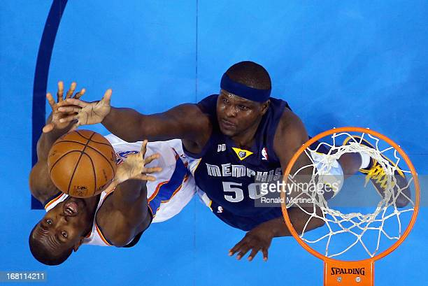 Serge Ibaka of the Oklahoma City Thunder jumps for a rebound against Zach Randolph of the Memphis Grizzlies during Game One of the Western Conference...