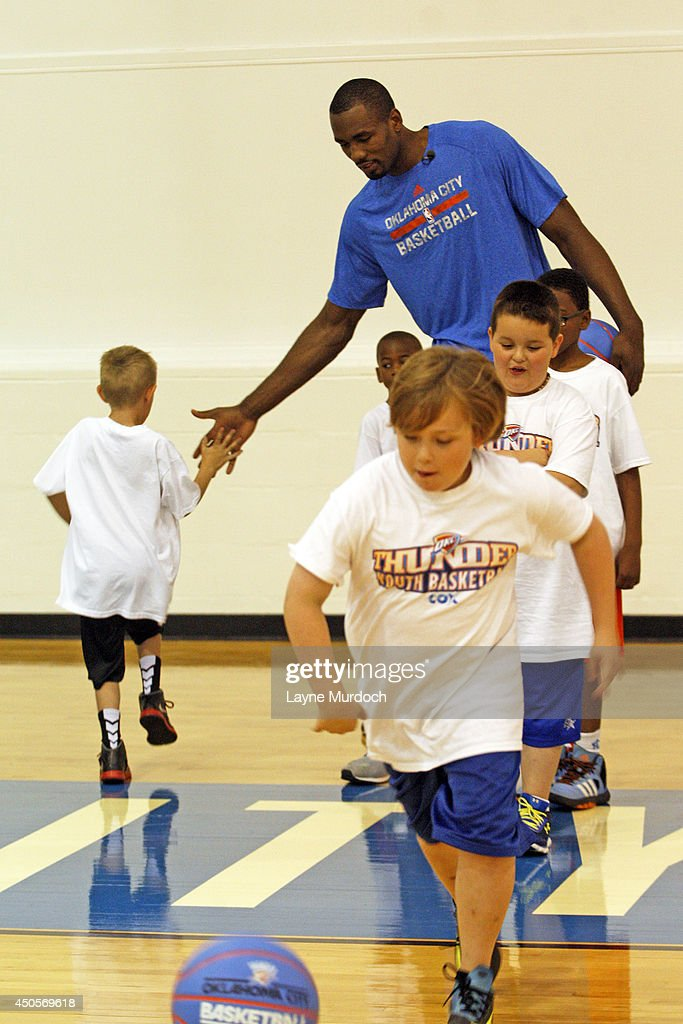 Serge Ibaka #9 of the Oklahoma City Thunder leads campers through basketball drills on June 3, 2014 at the Thunder Events Center in Edmond, Oklahoma. This is the teams first junior camp, designed for kids ages 5-9 to develop their basketball skills and grow in life lessons such as teamwork, sportsmanship and respect.