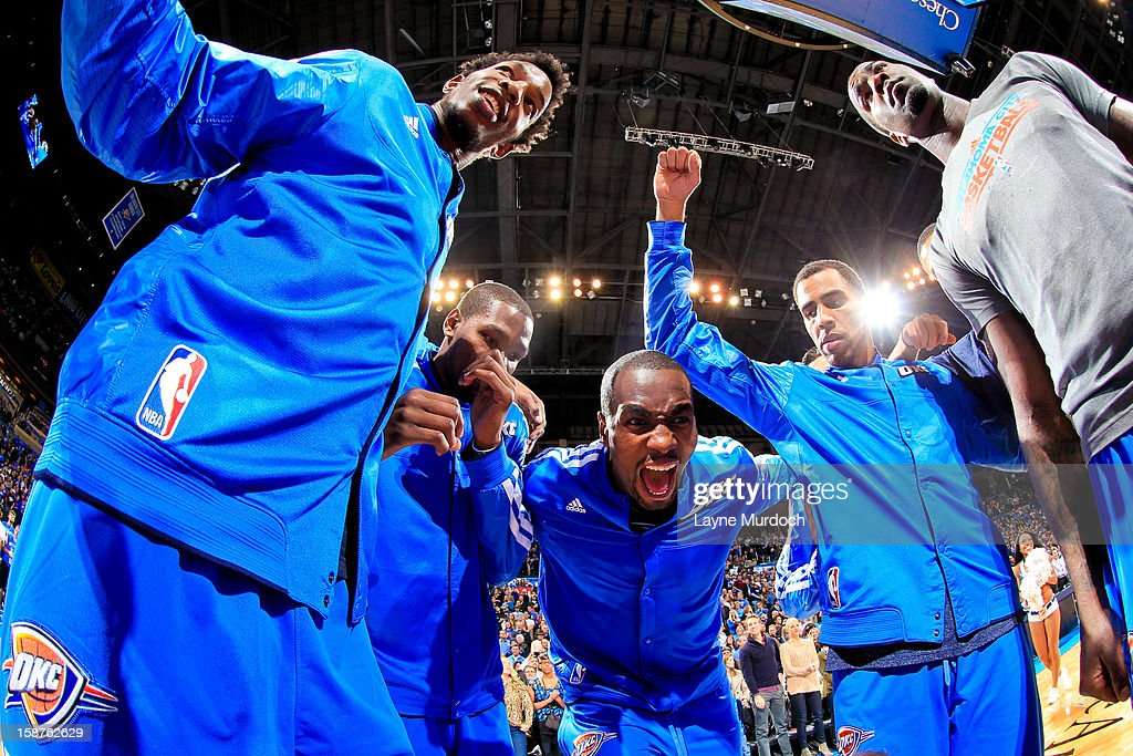 <a gi-track='captionPersonalityLinkClicked' href=/galleries/search?phrase=Serge+Ibaka&family=editorial&specificpeople=5133378 ng-click='$event.stopPropagation()'>Serge Ibaka</a> #9 of the Oklahoma City Thunder leads his team in a huddle before playing the Dallas Mavericks on December 27, 2012 at the Chesapeake Energy Arena in Oklahoma City, Oklahoma.