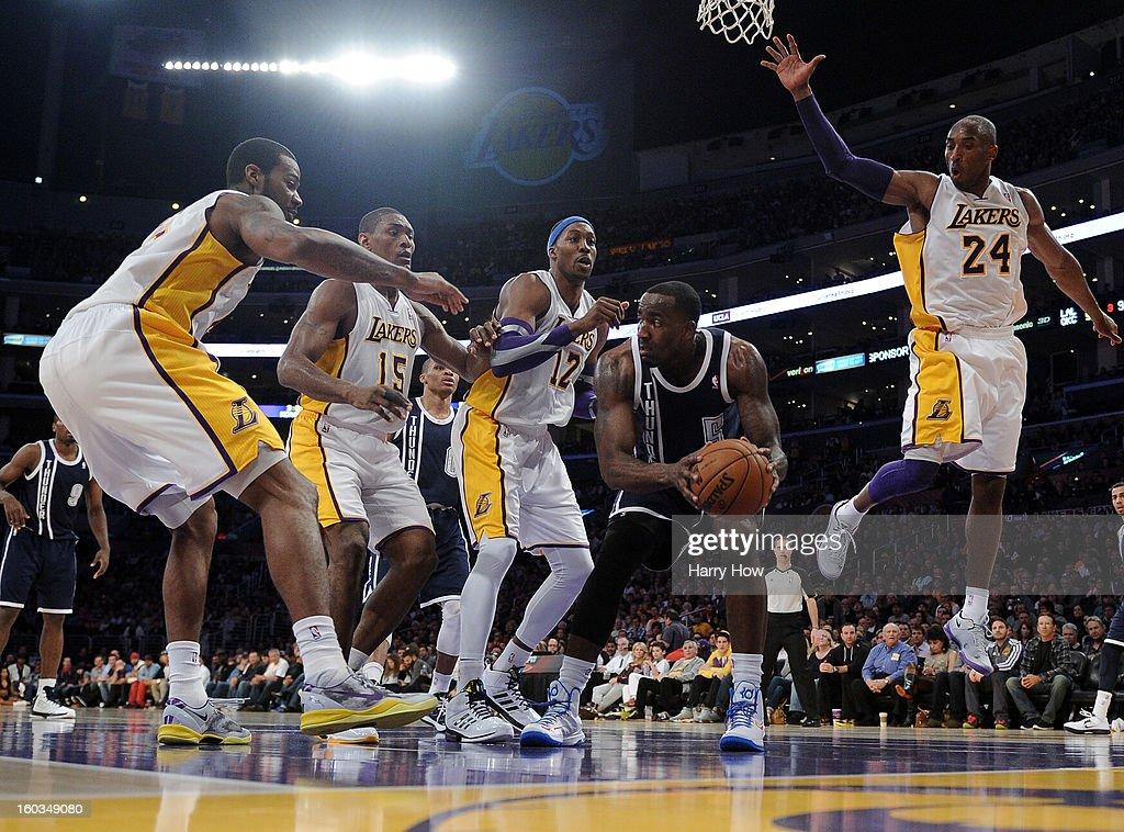 Serge Ibaka #9 of the Oklahoma City Thunder looks to pass around the defense of Earl Clark #6, Metta World Peace #15, Dwight Howard #12 and Kobe Bryant #24 of the Los Angeles Lakers at Staples Center on January 27, 2013 in Los Angeles, California.