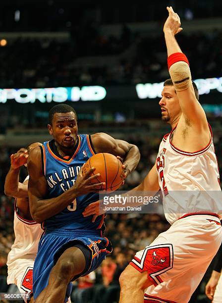 Serge Ibaka of the Oklahoma City Thunder moves past Brad Miller of the Chicago Bulls at the United Center on January 4 2010 in Chicago Illinois The...