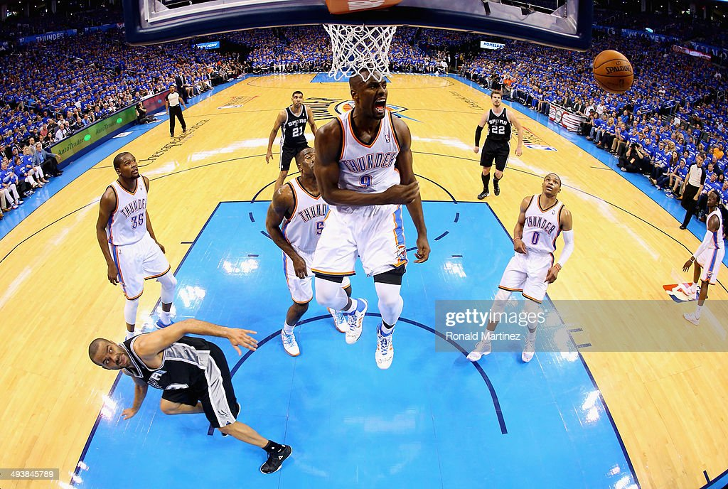Serge Ibaka #9 of the Oklahoma City Thunder reacts after blocking the shot of Tony Parker #9 of the San Antonio Spurs in the second half during Game Three of the Western Conference Finals of the 2014 NBA Playoffs at Chesapeake Energy Arena on May 25, 2014 in Oklahoma City, Oklahoma.