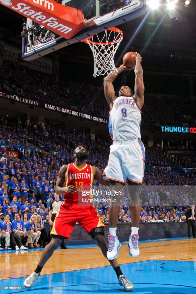 Serge Ibaka #9 of the Oklahoma City Thunder rises for a dunk against James Harden #13 of the Houston Rockets in Game Five of the Western Conference Quarterfinals during the 2013 NBA Playoffs on May 1, 2013 at the Chesapeake Energy Arena in Oklahoma City, Oklahoma.