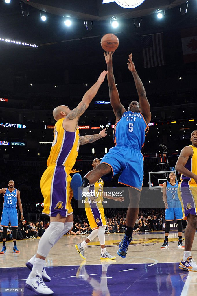 Serge Ibaka #9 of the Oklahoma City Thunder shoot against Robert Sacre #50 of the Los Angeles Lakers at Staples Center on January 11, 2013 in Los Angeles, California.