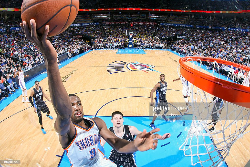 <a gi-track='captionPersonalityLinkClicked' href=/galleries/search?phrase=Serge+Ibaka&family=editorial&specificpeople=5133378 ng-click='$event.stopPropagation()'>Serge Ibaka</a> #9 of the Oklahoma City Thunder shoots a layup against Nikola Vucevic #9 of the Orlando Magic on March 15, 2013 at the Chesapeake Energy Arena in Oklahoma City, Oklahoma.
