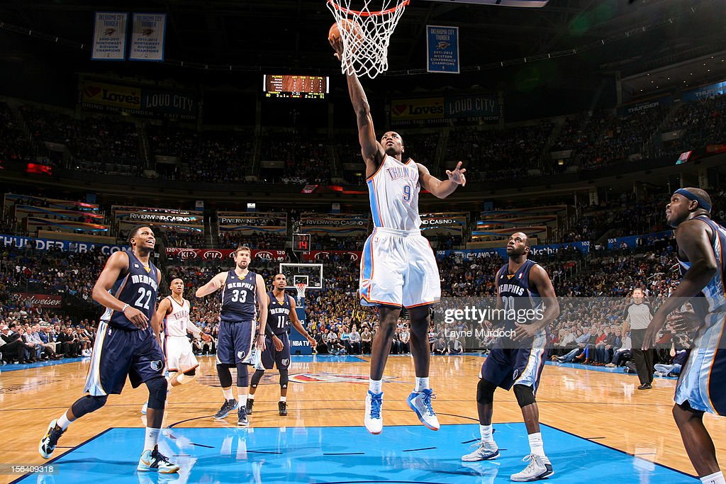 <a gi-track='captionPersonalityLinkClicked' href=/galleries/search?phrase=Serge+Ibaka&family=editorial&specificpeople=5133378 ng-click='$event.stopPropagation()'>Serge Ibaka</a> #9 of the Oklahoma City Thunder shoots a layup against the Memphis Grizzlies on November 14, 2012 at the Chesapeake Energy Arena in Oklahoma City, Oklahoma.