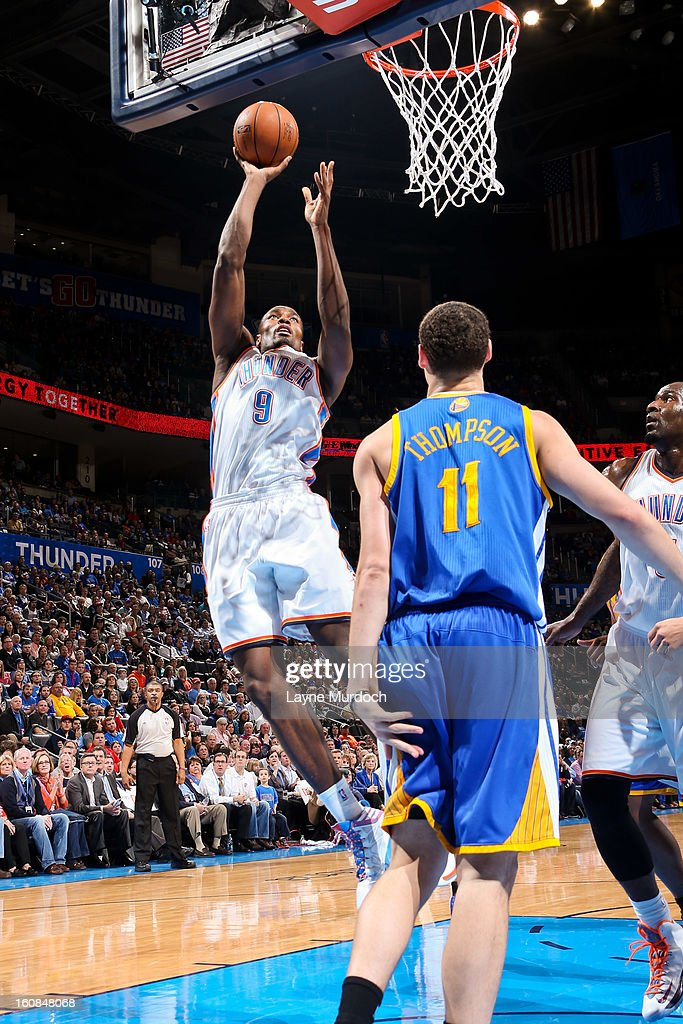 Serge Ibaka #9 of the Oklahoma City Thunder shoots a layup against the Golden State Warriors on February 6, 2013 at the Chesapeake Energy Arena in Oklahoma City, Oklahoma.