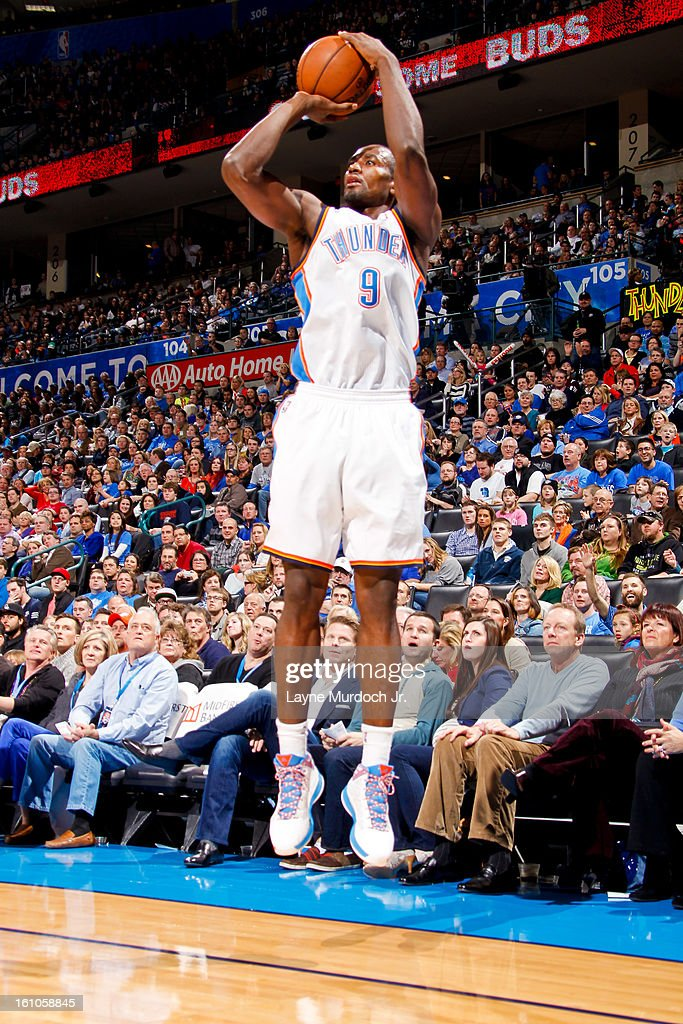 Serge Ibaka #9 of the Oklahoma City Thunder shoots a three-pointer against the Phoenix Suns on February 8, 2013 at the Chesapeake Energy Arena in Oklahoma City, Oklahoma.