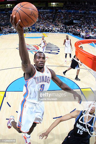 Serge Ibaka of the Oklahoma City Thunder shoots against Anthony Randolph of the Minnesota Timberwolves on March 25 2011 at the Oklahoma City Arena in...