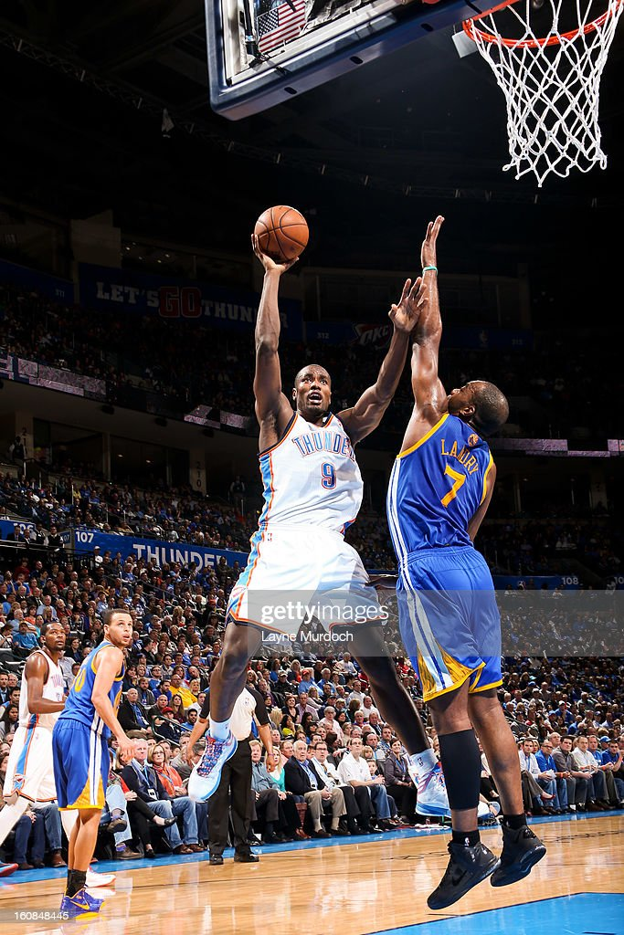 Serge Ibaka #9 of the Oklahoma City Thunder shoots against Carl Landry #7 of the Golden State Warriors on February 6, 2013 at the Chesapeake Energy Arena in Oklahoma City, Oklahoma.
