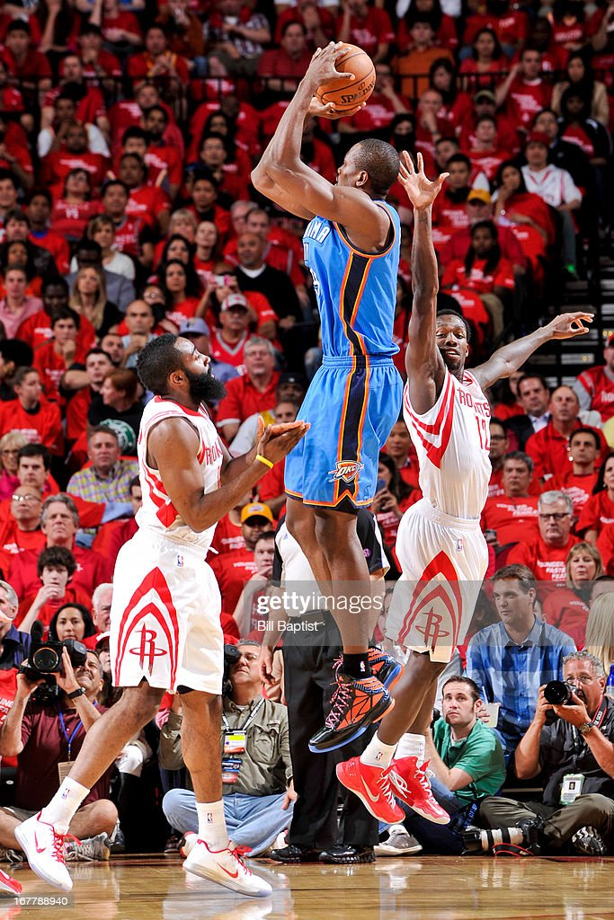 Serge Ibaka #9 of the Oklahoma City Thunder shoots against James Harden #13 and Patrick Beverley #12 of the Houston Rockets in Game Four of the Western Conference Quarterfinals during the 2013 NBA Playoffs on April 29, 2013 at the Toyota Center in Houston, Texas.