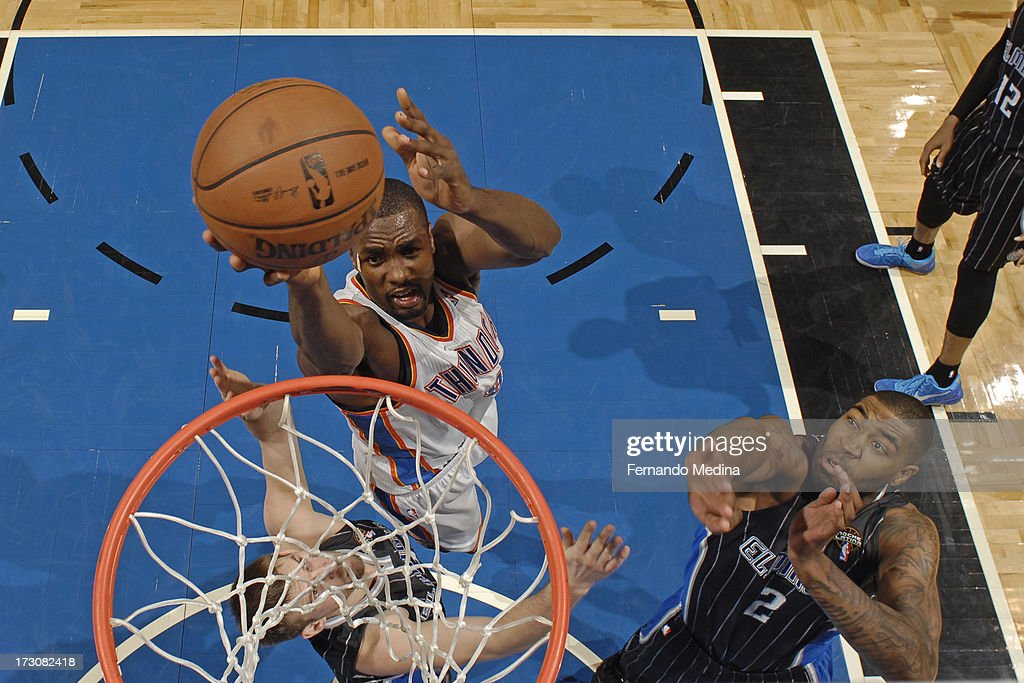 <a gi-track='captionPersonalityLinkClicked' href=/galleries/search?phrase=Serge+Ibaka&family=editorial&specificpeople=5133378 ng-click='$event.stopPropagation()'>Serge Ibaka</a> #9 of the Oklahoma City Thunder shoots against <a gi-track='captionPersonalityLinkClicked' href=/galleries/search?phrase=Kyle+O%27Quinn&family=editorial&specificpeople=9027719 ng-click='$event.stopPropagation()'>Kyle O'Quinn</a> #2 of the Orlando Magic on March 22, 2013 at Amway Center in Orlando, Florida.