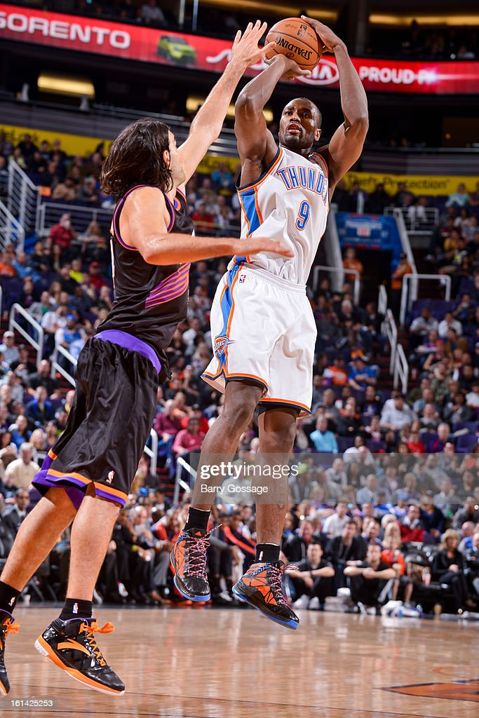 Serge Ibaka #9 of the Oklahoma City Thunder shoots against Luis Scola #14 of the Phoenix Suns on February 10, 2013 at U.S. Airways Center in Phoenix, Arizona.