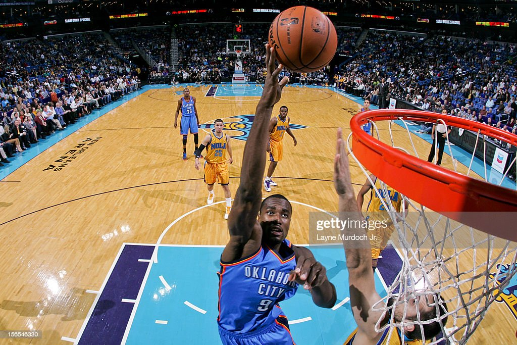 <a gi-track='captionPersonalityLinkClicked' href=/galleries/search?phrase=Serge+Ibaka&family=editorial&specificpeople=5133378 ng-click='$event.stopPropagation()'>Serge Ibaka</a> #9 of the Oklahoma City Thunder shoots against Ryan Anderson #33 of the New Orleans Hornets on November 16, 2012 at the New Orleans Arena in New Orleans, Louisiana.