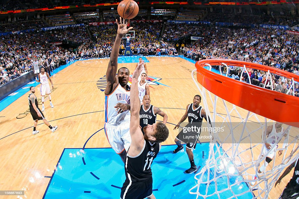<a gi-track='captionPersonalityLinkClicked' href=/galleries/search?phrase=Serge+Ibaka&family=editorial&specificpeople=5133378 ng-click='$event.stopPropagation()'>Serge Ibaka</a> #9 of the Oklahoma City Thunder shoots in the lane against <a gi-track='captionPersonalityLinkClicked' href=/galleries/search?phrase=Brook+Lopez&family=editorial&specificpeople=3847328 ng-click='$event.stopPropagation()'>Brook Lopez</a> #11 of the Brooklyn Nets on January 2, 2013 at the Chesapeake Energy Arena in Oklahoma City, Oklahoma.
