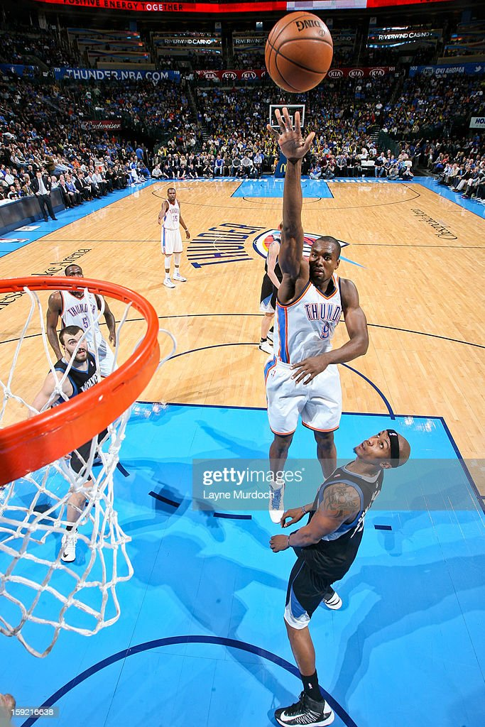 <a gi-track='captionPersonalityLinkClicked' href=/galleries/search?phrase=Serge+Ibaka&family=editorial&specificpeople=5133378 ng-click='$event.stopPropagation()'>Serge Ibaka</a> #9 of the Oklahoma City Thunder shoots in the lane against <a gi-track='captionPersonalityLinkClicked' href=/galleries/search?phrase=Dante+Cunningham&family=editorial&specificpeople=683729 ng-click='$event.stopPropagation()'>Dante Cunningham</a> #33 of the Minnesota Timberwolves on January 9, 2013 at the Chesapeake Energy Arena in Oklahoma City, Oklahoma.