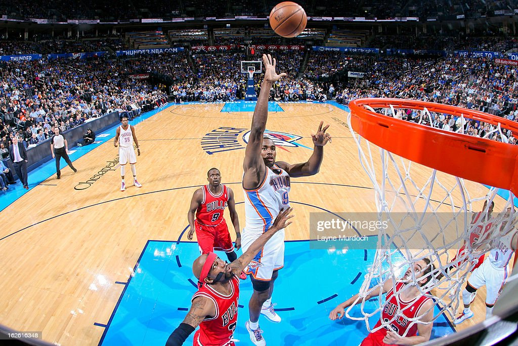 <a gi-track='captionPersonalityLinkClicked' href=/galleries/search?phrase=Serge+Ibaka&family=editorial&specificpeople=5133378 ng-click='$event.stopPropagation()'>Serge Ibaka</a> #9 of the Oklahoma City Thunder shoots in the lane against Richard Hamilton #32 of the Chicago Bulls on February 24, 2013 at the Chesapeake Energy Arena in Oklahoma City, Oklahoma.