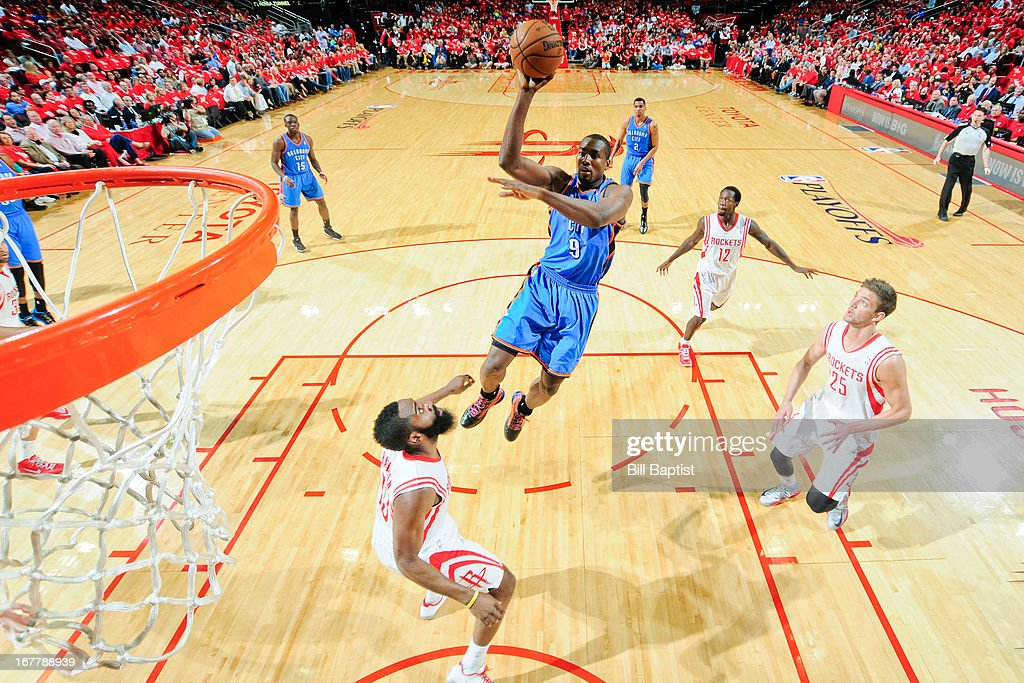 <a gi-track='captionPersonalityLinkClicked' href=/galleries/search?phrase=Serge+Ibaka&family=editorial&specificpeople=5133378 ng-click='$event.stopPropagation()'>Serge Ibaka</a> #9 of the Oklahoma City Thunder shoots in the lane against <a gi-track='captionPersonalityLinkClicked' href=/galleries/search?phrase=James+Harden&family=editorial&specificpeople=4215938 ng-click='$event.stopPropagation()'>James Harden</a> #13 of the Houston Rockets in Game Four of the Western Conference Quarterfinals during the 2013 NBA Playoffs on April 29, 2013 at the Toyota Center in Houston, Texas.