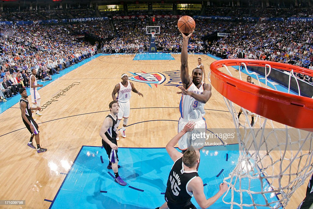 <a gi-track='captionPersonalityLinkClicked' href=/galleries/search?phrase=Serge+Ibaka&family=editorial&specificpeople=5133378 ng-click='$event.stopPropagation()'>Serge Ibaka</a> #9 of the Oklahoma City Thunder shoots in the lane against <a gi-track='captionPersonalityLinkClicked' href=/galleries/search?phrase=Cole+Aldrich&family=editorial&specificpeople=4226189 ng-click='$event.stopPropagation()'>Cole Aldrich</a> #45 of the Sacramento Kings on April 15, 2013 at the Chesapeake Energy Arena in Oklahoma City, Oklahoma.