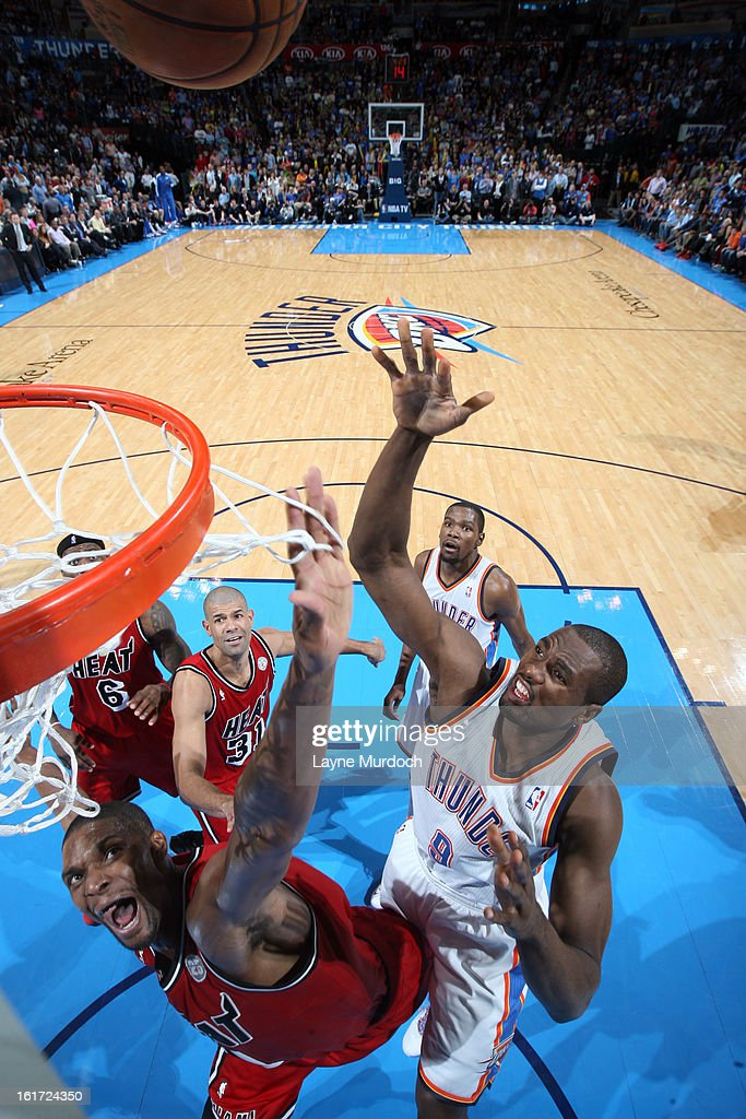 Serge Ibaka #9 of the Oklahoma City Thunder shoots over the Miami Heat during an NBA game on February 14, 2013 at the Chesapeake Energy Arena in Oklahoma City, Oklahoma.