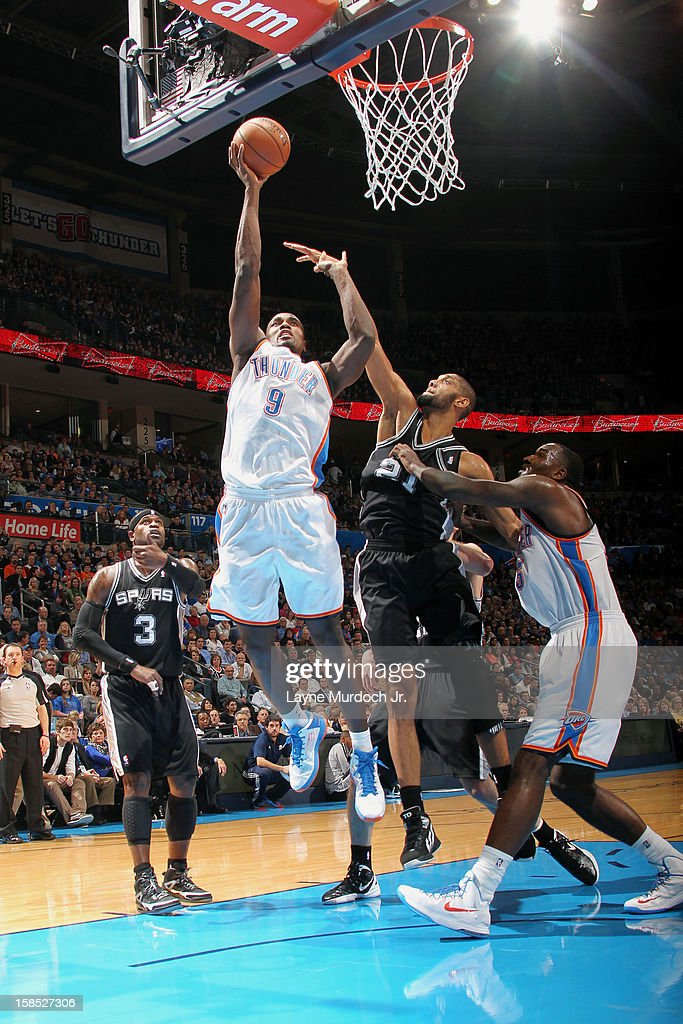 <a gi-track='captionPersonalityLinkClicked' href=/galleries/search?phrase=Serge+Ibaka&family=editorial&specificpeople=5133378 ng-click='$event.stopPropagation()'>Serge Ibaka</a> #9 of the Oklahoma City Thunder shoots over <a gi-track='captionPersonalityLinkClicked' href=/galleries/search?phrase=Tim+Duncan&family=editorial&specificpeople=201467 ng-click='$event.stopPropagation()'>Tim Duncan</a> #21 of the San Antonio Spurs during an NBA game on December 17, 2012 at the Chesapeake Energy Arena in Oklahoma City, Oklahoma.