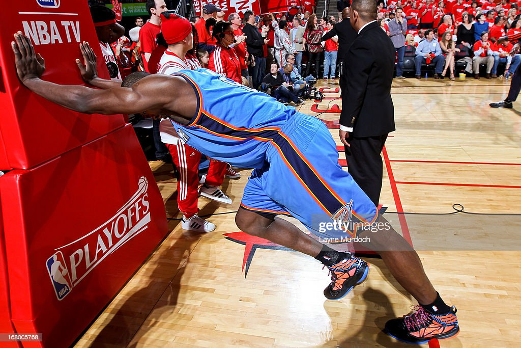 Serge Ibaka #9 of the Oklahoma City Thunder stretches before playing against the Houston Rockets in Game Six of the Western Conference Quarterfinals during the 2013 NBA Playoffs on May 3, 2013 at the Toyota Center in Houston, Texas.