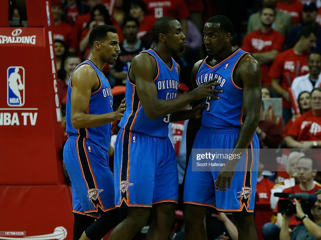 Serge Ibaka #9 (C) of the Oklahoma City Thunder tries to clam down his teammate Kendrick Perkins #5 as Thabo Sefolosha #2 looks on during the game against the Houston Rockets in Game Six of the Western Conference Quarterfinals of the 2013 NBA Playoffs at the Toyota Center on May 3, 2013 in Houston, Texas.