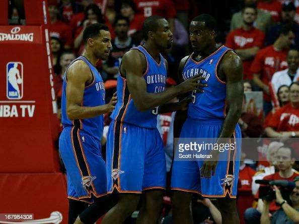 Serge Ibaka of the Oklahoma City Thunder tries to clam down his teammate Kendrick Perkins as Thabo Sefolosha looks on during the game against the...