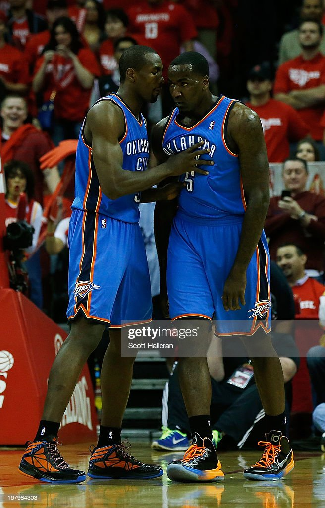 Serge Ibaka #9 of the Oklahoma City Thunder tries to clam down his teammate Kendrick Perkins #5 during the game against the Houston Rockets in Game Six of the Western Conference Quarterfinals of the 2013 NBA Playoffs at the Toyota Center on May 3, 2013 in Houston, Texas.