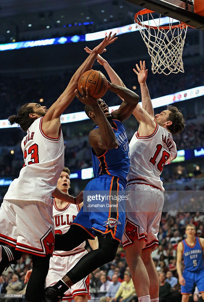 Serge Ibaka of the Oklahoma City Thunder tries to shoot between Joakim Noah and Pau Gasol of the Chicago Bulls at the United Center on March 5 2015...