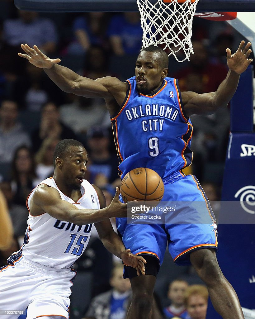 Serge Ibaka #9 of the Oklahoma City Thunder tries to stop Kemba Walker #15 of the Charlotte Bobcats during their game at Time Warner Cable Arena on March 8, 2013 in Charlotte, North Carolina.