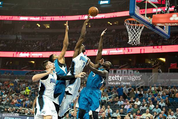 Serge Ibaka of the Orlando Magic attempts a shot against Gorgui Dieng of the Minnesota Timberwolves during the game on November 9 2016 at Amway...