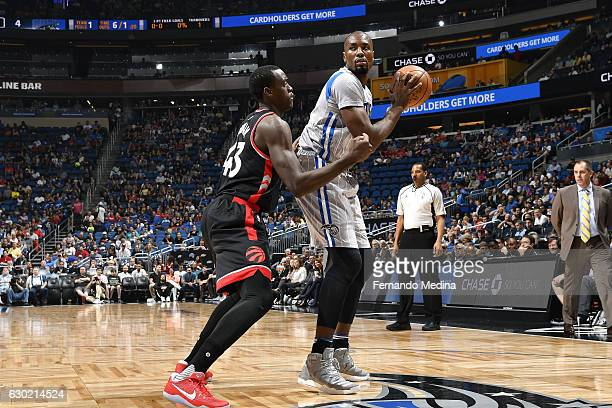 Serge Ibaka of the Orlando Magic handles the ball during the game against the Toronto Raptors on December 18 2016 at Amway Center in Orlando Florida...