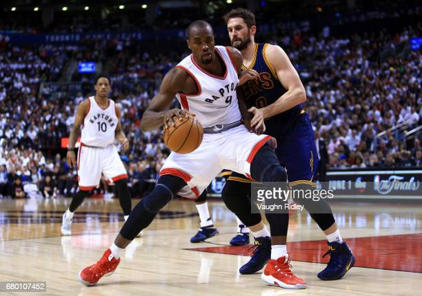 Serge Ibaka of the Toronto Raptors dribbles the ball as Kevin Love of the Cleveland Cavaliers defends in the second half of Game Four of the Eastern...