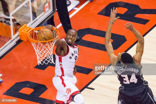 TORONTO ON APRIL 24 Serge Ibaka of the Toronto Raptors dunks over Giannis Antetokounmpo of the Bucks during the first half of NBA action as the...