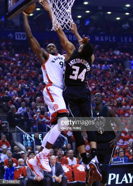 Serge Ibaka of the Toronto Raptors dunks the ball as Giannis Antetokounmpo of the Milwaukee Bucks defends in the first half of Game Five of the...