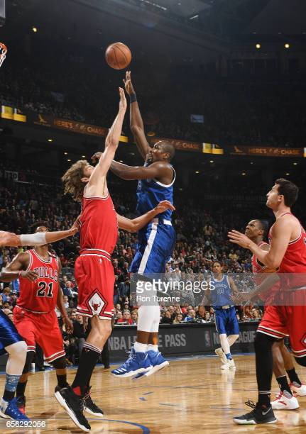 Serge Ibaka of the Toronto Raptors goes for the tip off against Robin Lopez of the Chicago Bulls during the game on March 21 2017 at the Air Canada...