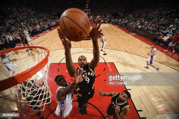 Serge Ibaka of the Toronto Raptors goes up for a rebound during a game against the Philadelphia 76ers on April 2 2017 at the Air Canada Centre in...